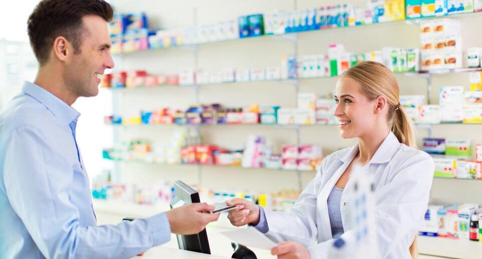 pharmacist with male customer