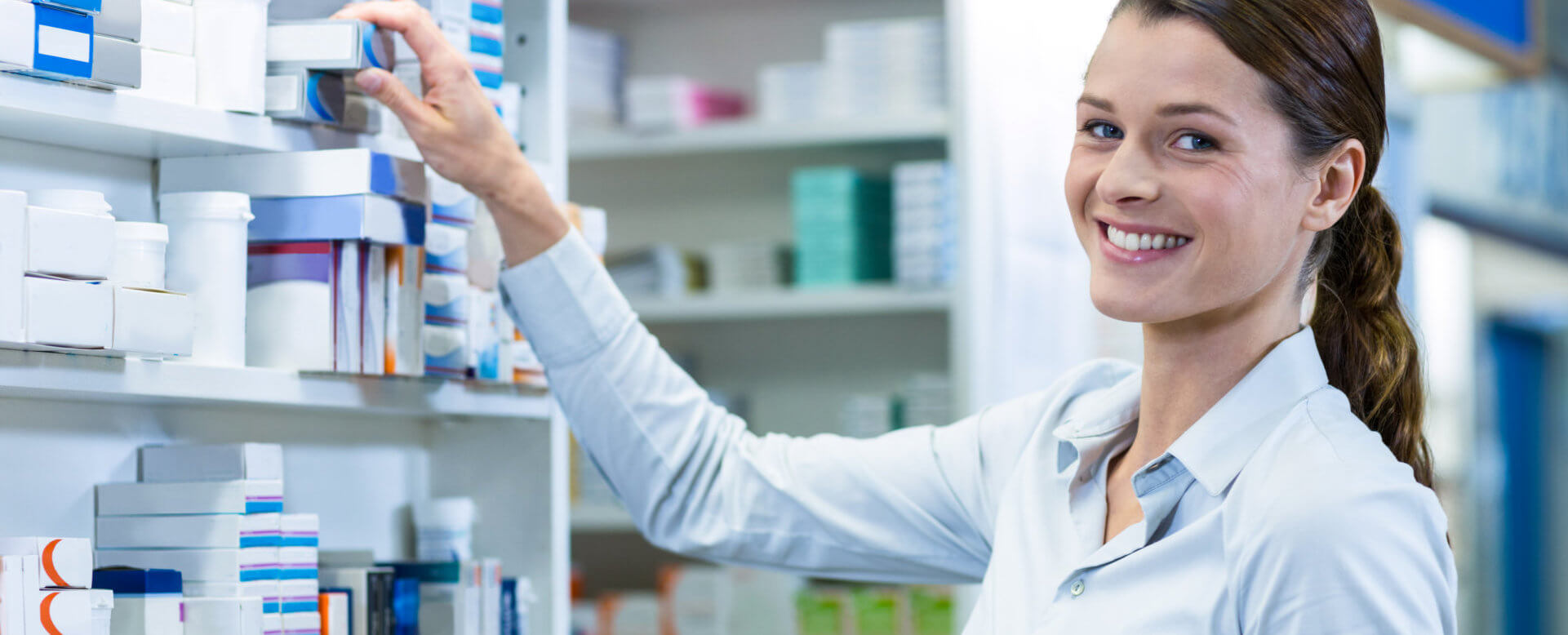 woman holding box of medicine