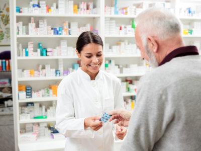 female pharmacist with customer