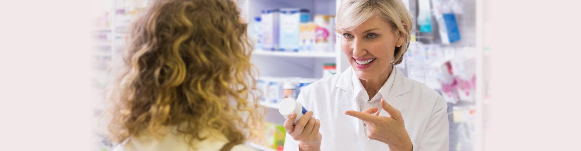 female pharmacist with female customer
