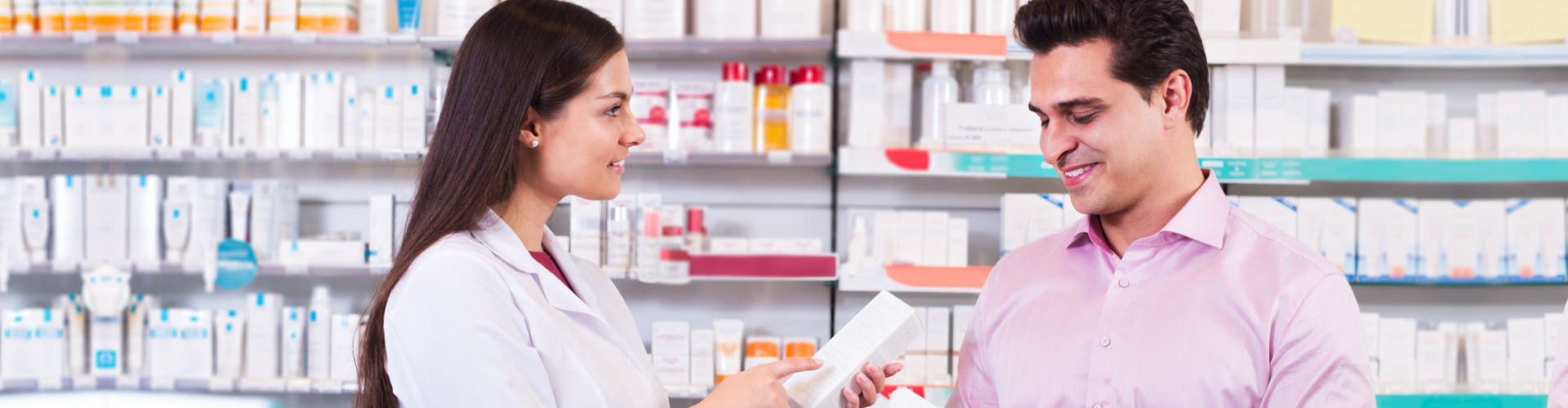 female pharmacist with male customer